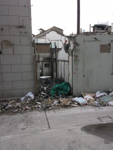 Debris in front of a almost torn down Shikumen to make room for more high rises