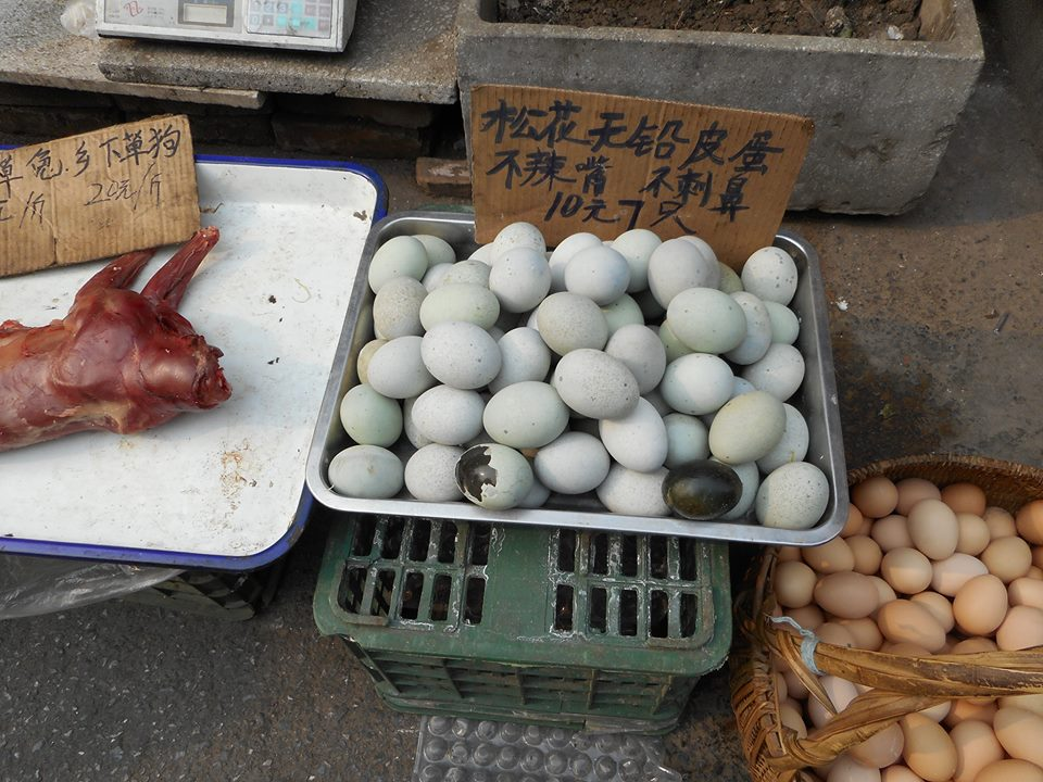 Century eggs with suckling pig on the left
