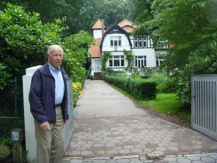 In front of his birth house in Wohltorf, near Hamburg, Germany